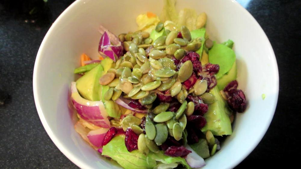 Salad with avocados, cranberries and pumpkin seeds. Easy, healthy, tasty meals